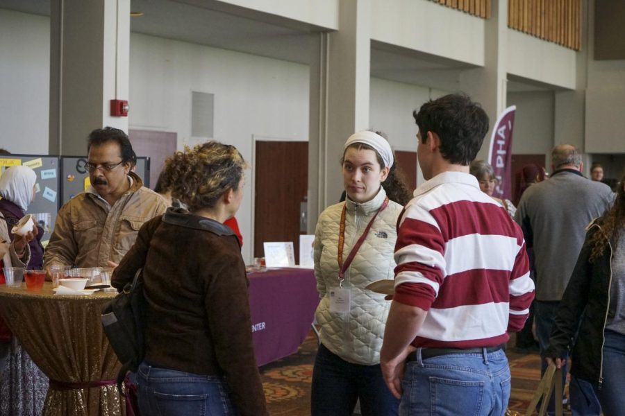 Prospective students talk to Loyola staff members during Admitted Students Day back in March 2020. Due to COVID-19, admissions has had to transition from in-person tours to online marketing techniques in order to recruit graduating high school seniors. Photo credit: Cristian Orellana