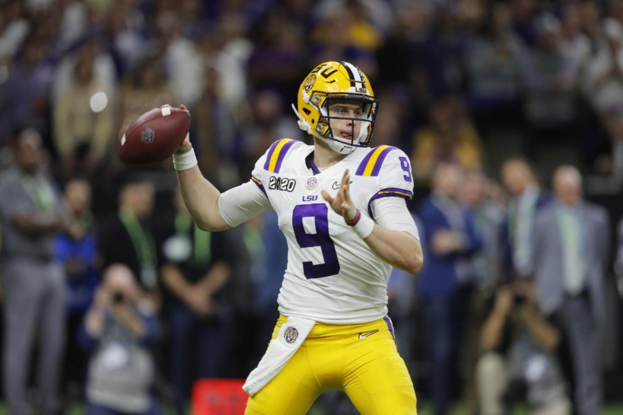 FILE - In this Jan. 13, 2020, file photo, LSU quarterback Joe Burrow throws a pass against Clemson during the second half of the NCAA College Football Playoff national championship game in New Orleans. The Cincinnati Bengals chose Burrow with the first pick in the NFL draft Thursday, April. 23, 2020. (AP Photo/Gerald Herbert, File)