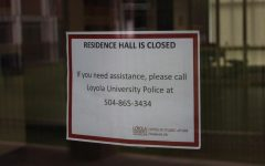 A sign that residence halls are closed due to COVID-19 is posted on the door to Carrollton Hall on May 17, 2020. Upperclassmen were notified in a May 21 email that they would no longer be provided on-campus housing for the fall 2020 semester in order to decrease the density of students on campus due to COVID-19 safety concerns.