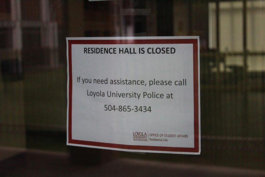 A+sign+that+residence+halls+are+closed+due+to+COVID-19+is+posted+on+the+door+to+Carrollton+Hall+on+May+17%2C+2020.+Upperclassmen+were+notified+in+a+May+21+email+that+they+would+no+longer+be+provided+on-campus+housing+for+the+fall+2020+semester+in+order+to+decrease+the+density+of+students+on+campus+due+to+COVID-19+safety+concerns.
