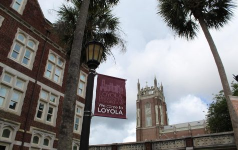 A 'Welcome to Loyola' sign waves outside Thomas Hall on May 17, 2020. The university posted a fall 2020 schedule to its website on May 19 that says the university will resume on-campus classes Aug. 24 with online classes and finals between Thanksgiving and the spring semester. Photo credit: Alexandria Whitten