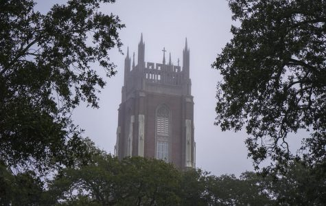 Fog sits over Holy Name of Jesus Church on Loyola's campus in early 2020. Loyola's residence halls will open May 18-24 for students who left campus quickly due to COVID-19 to retrieve any belongings left behind, according to an email from the Office of Residential Life. Photo credit: Cristian Orellana