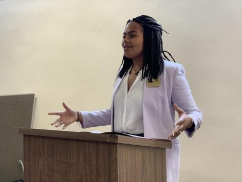 Jessamyn Reichmann, SGA President, addresses the student body on Wednesday, March 11. Photo credit: Cristian Orellana