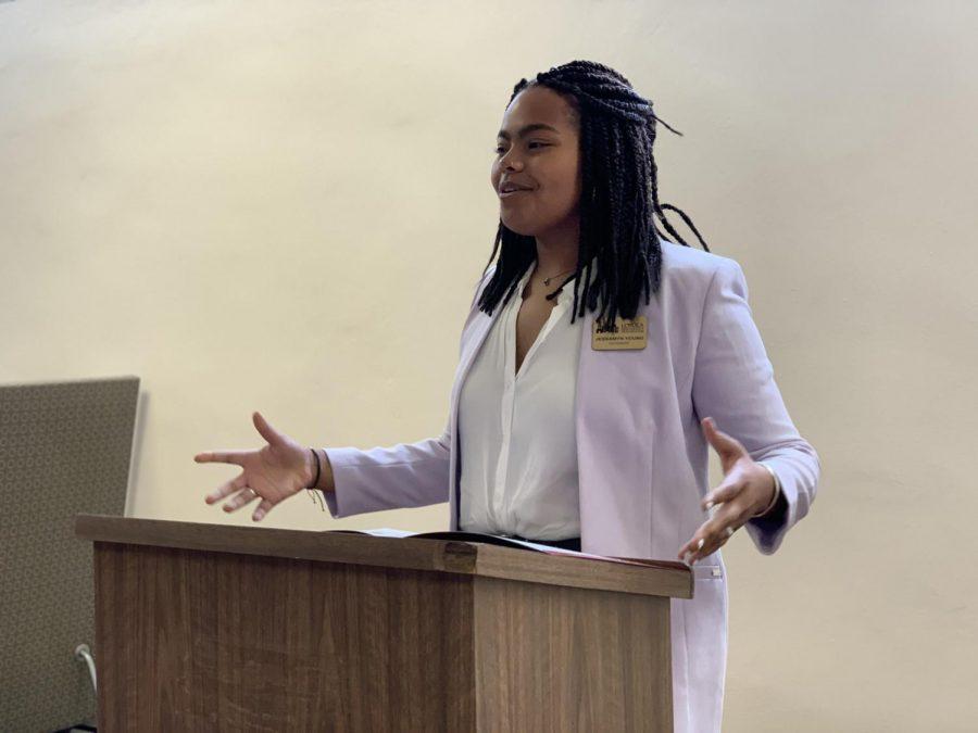 Jessamyn Reichmann, SGA President, addresses the student body on Wednesday, March 11. Photo credit: Cristian Orellana