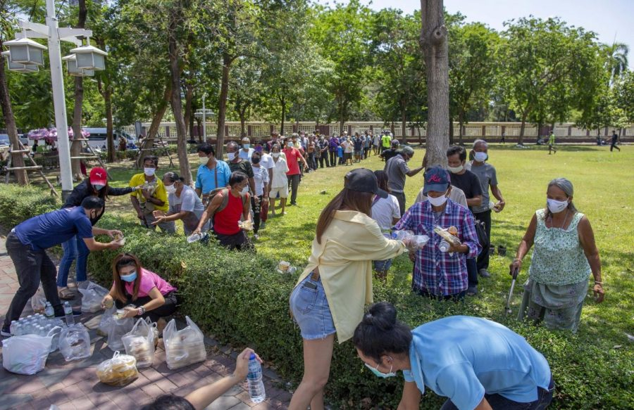 Locals+affected+by+the+anti-coronavirus+government+measures+receive+free+meals+in+a+park+in+central+Bangkok%2C+Thailand%2C+Tuesday%2C+April+21%2C+2020.+Some+Buddhist+monasteries+and+sympathizers+provide+meals+for+people+in+need%2C+whose+livelihoods+have+been+affected+due+to+the+emergency+regulations+enforced+in+Thailand+to+control+the+coronavirus+that+has+infected+hundreds+of+people+in+the+Southeast+Asian+country.+%28AP+Photo%2FGemunu+Amarasinghe%29
