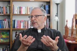 The Rev. Ted Dziak, S.J., sits in his office in the Department of Mission and Ministry on March 26, 2018. Dziak announced that he will be gping on a year-long sabbatical as well as resigning from his role as Vice President for Mission and Identity. Photo credit: Jawdat Tinawi Photo credit: Jawdat Tinawi