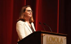 President Tania Tetlow addresses the Loyola community at the President's Convocation in 2018. Photo credit: Sidney Ovrom