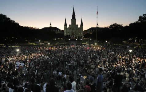 People attend a rally outside Jackson Square in New Orleans, Friday, June 5, 2020, protesting the death of George Floyd who died after being restrained by Minneapolis police officers on May 25. (AP Photo/Gerald Herbert)
