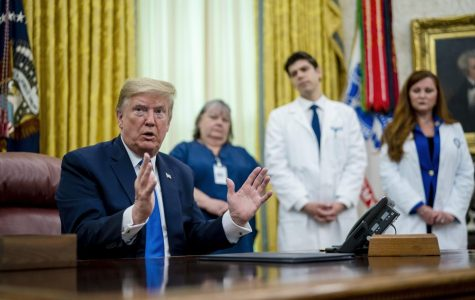 Loyola Grad Sophia Thomas joins President Donald Trump in the White House for national nurses day.