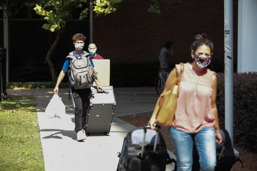 A student approaches Buddig Hall on Thursday, August 20. The university has decreased the number of students living on campus in order to allow distancing to occur more easily.