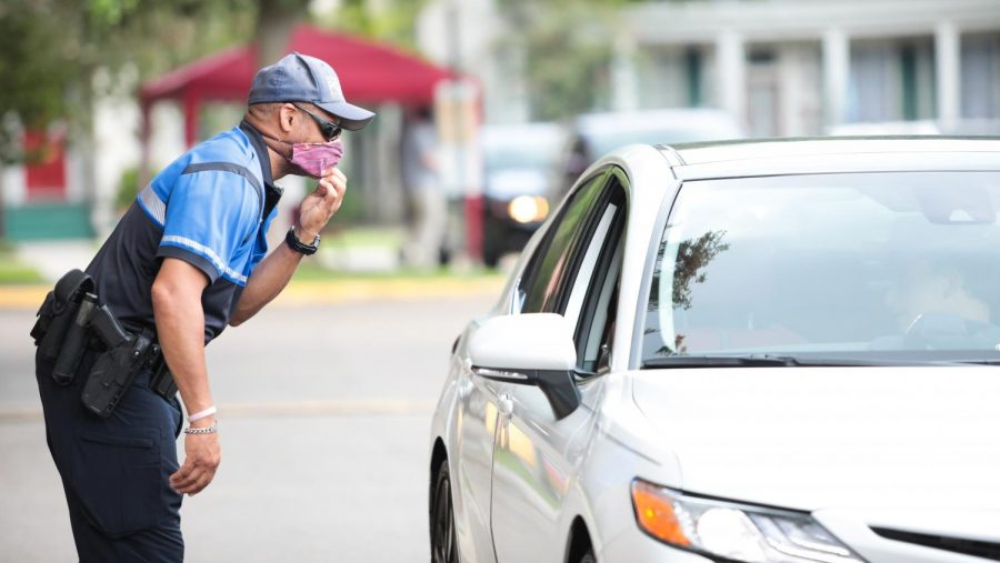 A LUPD officer assists during first-year move in on Thursday, August 20. This year's check-in procedures allowed individuals to stay socially distant.