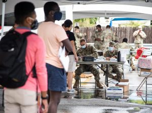 Members of the Louisiana National Guard sign students in for free on-campus testing in the parking lot of Mercy Hall Aug. 31. Photo credit: Michael Bauer