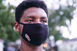 Omari Caldwell poses while wearing his university-provided mask on Friday, Aug. 28. Although the masks do follow CDC guidelines, the effectiveness of the face coverings have recently come under scrutiny from students.