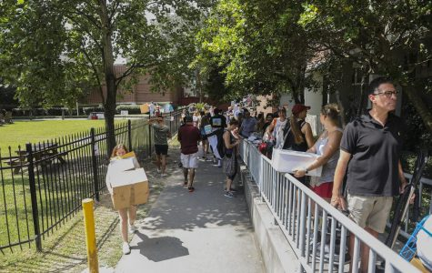 Students move into Buddig hall during move in on Thursday Aug. 15, 2019. The university is offering an opportunity to allow students to move onto campus with a delayed move-in date this semester.