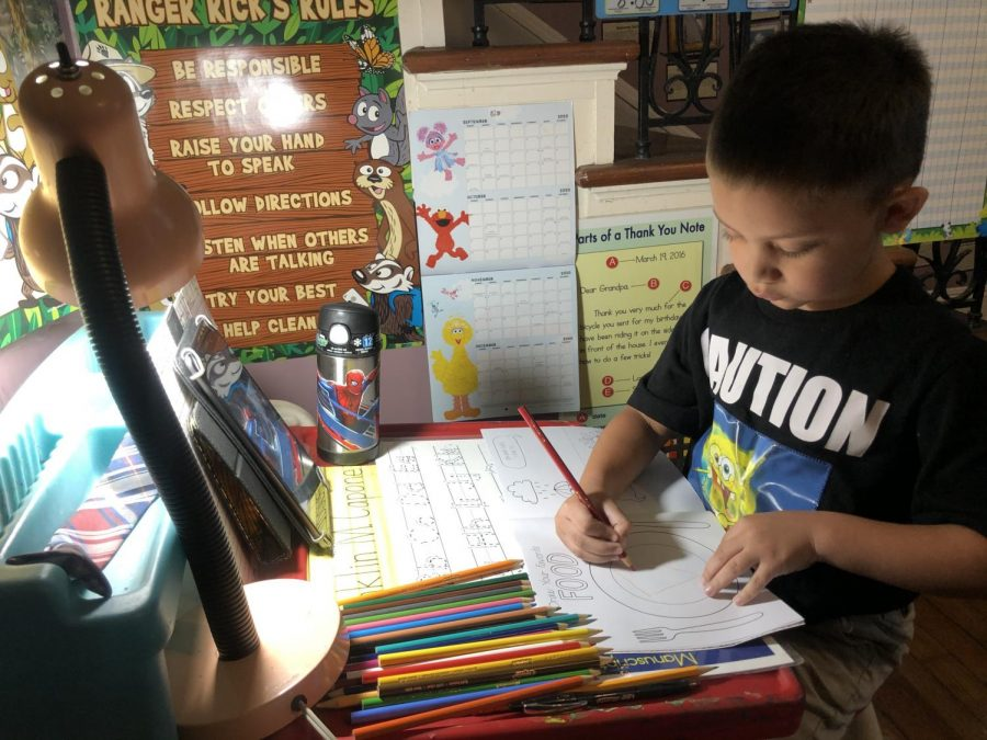 Megan Braden-Perry's six year old son works from home at his desk on schoolwork.