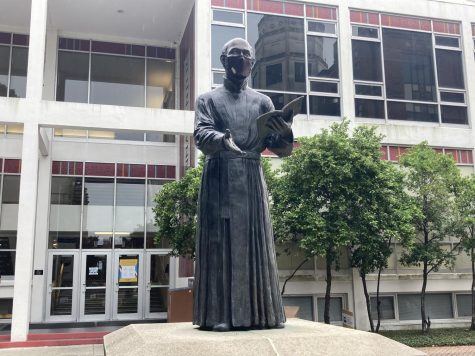 St. Ignatious statue showing how students can care for one another while on campus
