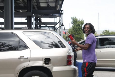 New Orleans resident pumps gas at Costco Sept. 14 ahead of Hurricane Sally. The Hurricane, which was recently upgraded to a Category 2 storm, is expected to hit the Gulf coast late Sept. 14 Photo credit: Jaime Jimenez