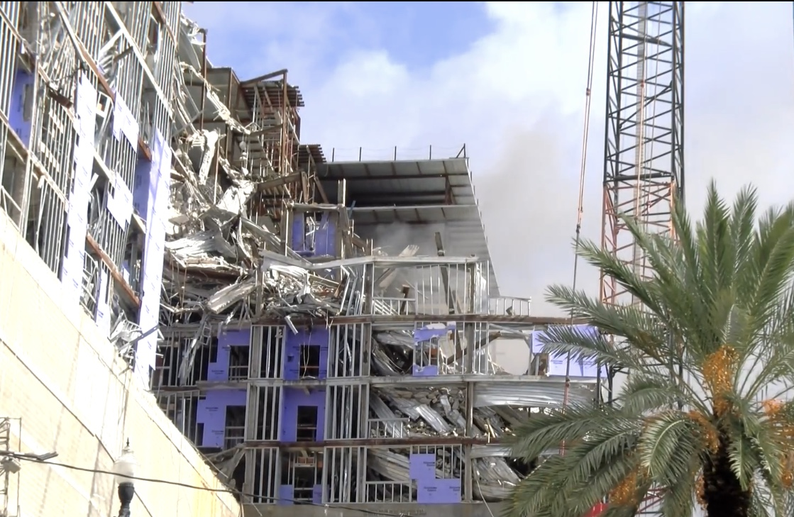 Dark smoke comes off the top of the Hard Rock Hotel collapse site roof Monday, Sept. 30, 2020. The hotel construction site collapsed nearly one year ago, killing three workers.