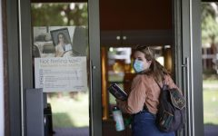 Loyola freshman Myranda Cook walks to her first in-person class in Monroe Hall on Sept. 3. Photo credit: Peter Buffo