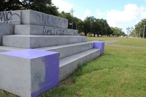 Graffiti covers the foundation that formerly held the Jefferson Davis Monument on Jeff Davis Parkway in New Orleans. The monument was removed in 2017 following protests. Photo credit: Alexandria Whitten