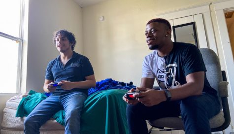 Musical theater junior Ryan Wiles plays video games in his apartment with his roommate Andres Paniagua. Wiles said that safe socializing and finding a sense of community through spending time with friends has helped him cope with the emotional strain of the COVID-19 pandemic. Photo courtesy of Ryan Wiles.