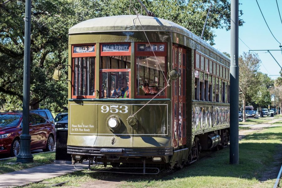 A streetcar heads down St. Charles Ave on October 23, 2019. The streetcar is a common symbol of New Orleans. Photo credit: Cristian Orellana