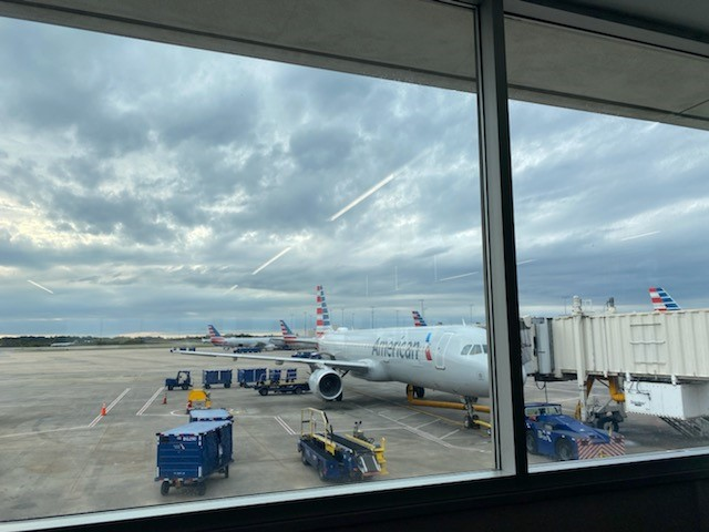 An American Airlines plane parks near a terminal gate for passengers to board aircraft. Passengers who refused to wear face coverings were escorted off of aircraft.