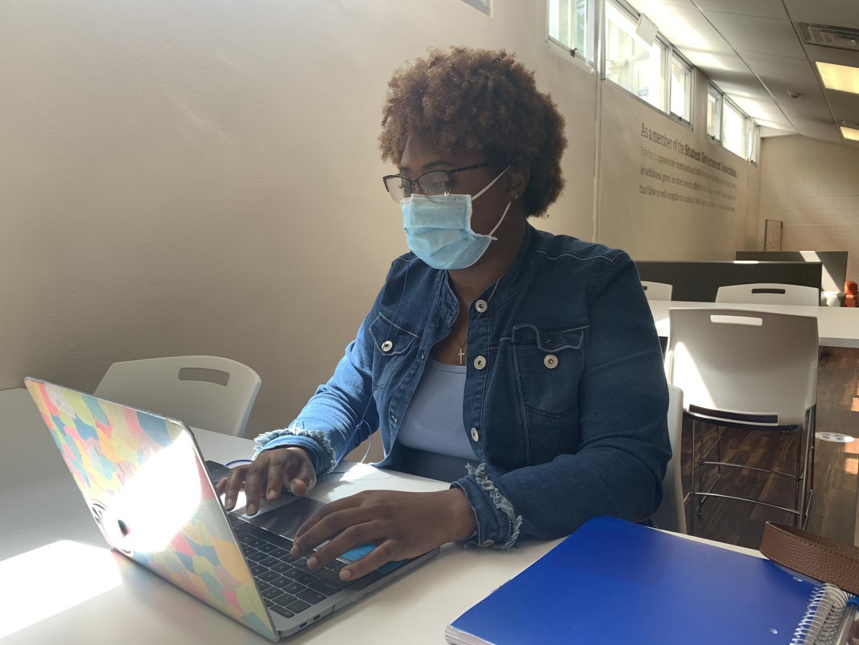 Talya Hammond works on her Women in African History homework in the SGA office on Sept. 25.