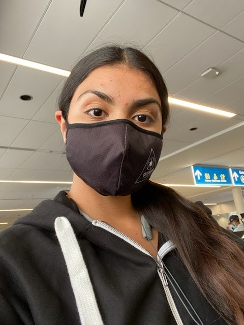 Rocio Valenzuela (pictured) wears a face mask in the Charlotte International Airport in North Carolina. All travelers are required to wear face coverings in the airport and on airplanes to reduce transmission of the COVID-19 virus.