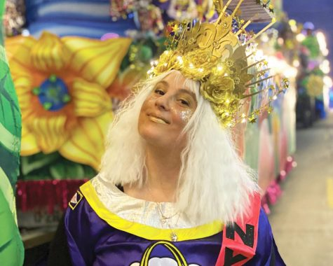 Loyola professor Lindsay Sproul stands beside her float in the Krewe of Nyx this Mardi Gras season. Sproul helped disband many members from the krewe after a leader posted an All Lives Matter post on Facebook.  Courtesy of Lindsay Sproul