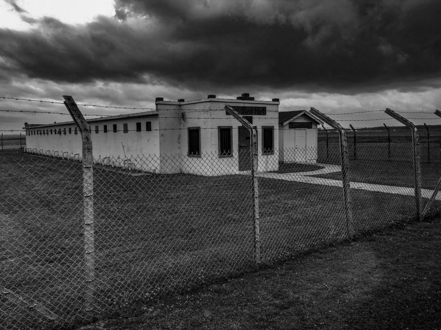 Clouds shadow the Red Hat Cell Block, a former restrictive housing unit at Louisiana State Penitentiary. The prison is the largest in Louisiana. Photo credit: Michael Bauer