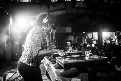 DJ Soul Sister, known for her music mixing abilities, is pictured playing a set pre-pandemic. DJ Soul Sister, also known as Melissa A. Weber, joined Loyola faculty this semester. Courtesy of Melissa A. Weber.