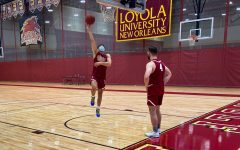 Andrew Stagni shoots a layup while warming up for practice in Loyola's sports complex Wednesday Sept. 30.  The men's basketball team is starting the season without senior forward Josh Leaney. Photo credit: Will Ingram