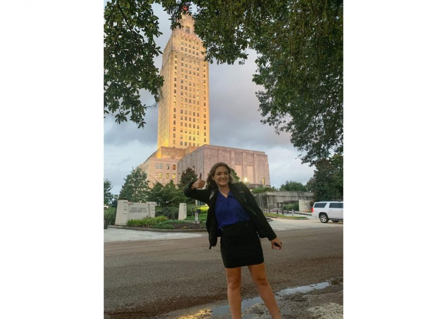 Alexis Horton poses in front of the Louisiana State Senate. She started working there at the start of the pandemic. Courtesy of Alexis Horton.