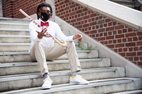 Sloan Brignac spins a cane while sitting on the front steps of Marquette Hall. Currently the sole member of Kappa Alpha Psi, Brignac hopes to recruit new members in order to ensure the fraternity