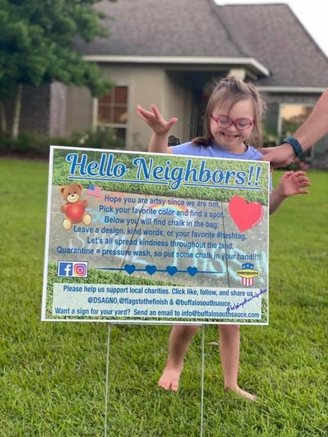 A little girl stands behind a sign with a poem on it asking people to leave a message in their neighborhood.  Ryan Mast created these signs and took them all around southeast Louisiana to stay connected with the community.  Courtesy of Ryan Mast.