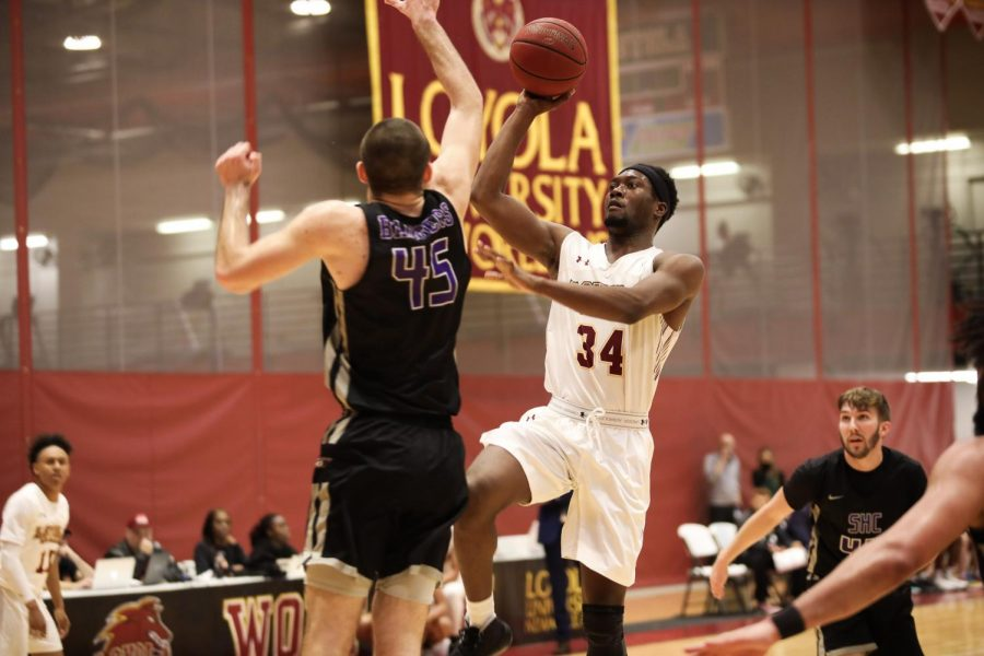 Wolf Pack forward Terry Smith Jr. shoots a runner against Spring Hill College. Both Loyola basketball teams earned NAIA National Tournament births during the 2019-2020 season before the winter sport championships were canceled. File Photo