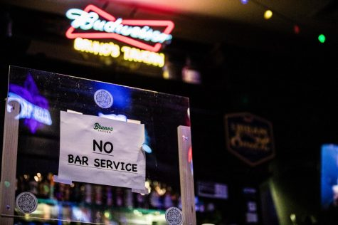 "A sign marked ""No Bar Service"" sits on the bar at Bruno"