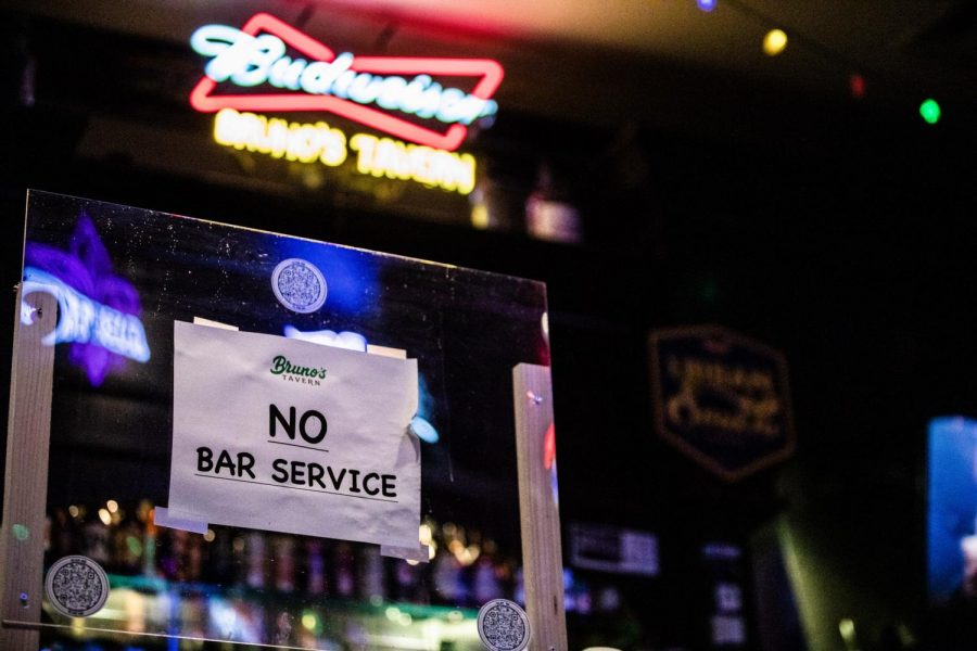 A+sign+marked+%22No+Bar+Service%22+sits+on+the+bar+at+Bruno%27s+Tavern.+Bruno%27s+is+one+of+many+bars+in+New+Orleans+that+has+been+forced+to+adapt+with+new+protocols+as+a+result+of+current+COVID-19+related+restrictions.+Photo+credit%3A+Michael+Bauer