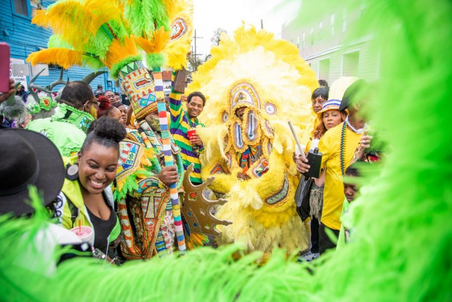 People celebrate in Central City as members of the Tomahawk Hunters and Golden Eagles, both Mardi Gras Indian tribes, clash at a ceremony on Mardi Gras day in 2020. With attempts to mitigate the spread of Covid-19, many of the usual aspects of Mardi Gras will be on hold for 2021, including a day off for Lundi Gras at Loyola. Photo credit: Michael Bauer