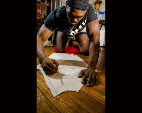 Mike Washington makes sketches for a Mardi Gras Indian costume.