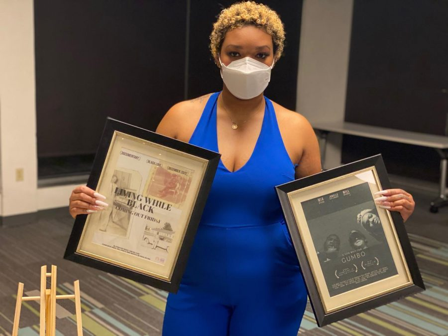 Mia Upshaw poses with her film posters at the University Programming Board's Black is Art event, Thursday, Feb. 18, 2021.