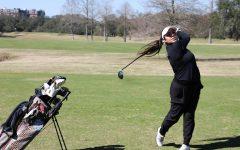 Alejandra Bedoya Tobar is on the backswing of her golf swing.