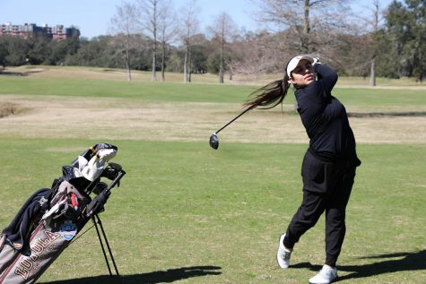 Alejandra Bedoya Tobar is on the backswing of her golf swing.