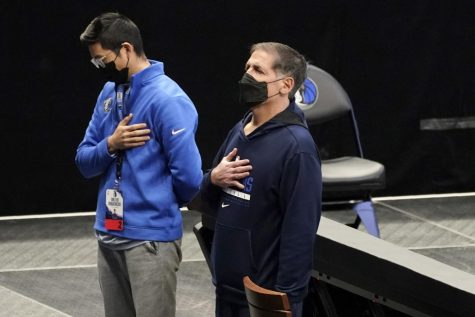 Mark Cuban, Dallas Mavericks owner, stands for the national anthem.