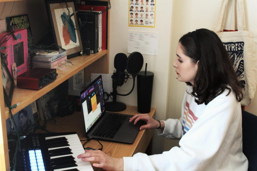 Gabrielle Garcia sits are her desk in her dorm room and creates music Feb. 1. Garcia is a Gilman recipient looking to further her musical theatre studies in South Korea this fall. Photo credit: Madeline Taliancich