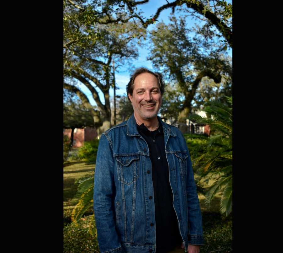 Robert Verchick, a future member of the Climate Emissions Task Force, poses in front of some greenery.