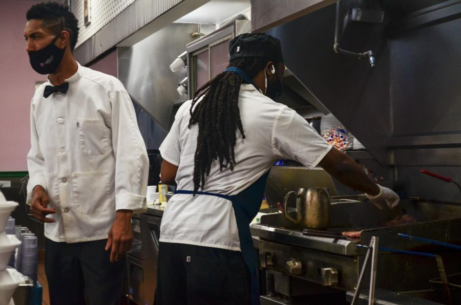 Employees of Camellia Grill work in the open kitchen of the restaurant on S Carrollton Ave. Loyola's workplace justice project make economic resources available to service workers in the city. Photo credit: Gabrielle Korein