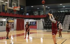 A Wolf Pack basketball player shoots a jump shot at team practice on March 5. The Loyola Womens basketball team earned a spot in the NAIA national championships after recording their eighth straight 20-win season. Photo credit: Shadera Moore