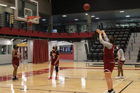 A Wolf Pack basketball player shoots a jump shot at team practice on March 5. The Loyola Women